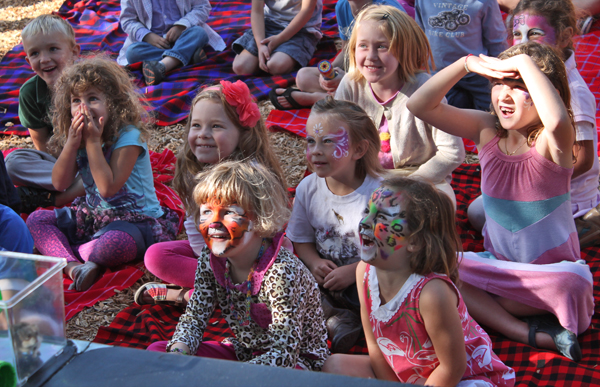 Kids watching Tracy Hill's animal show, photo by Auntie Stacey's Face Painting