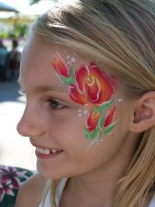 Roses face paint by Auntie Stacey, www.auntiestaceysfacepainting.com