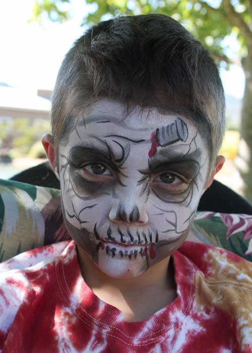 Skull face paint by Auntie Stacey, www.auntiestaceysfacepainting.com
