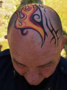 Tribal Fire Head body paint by Auntie Stacey's Face Painting