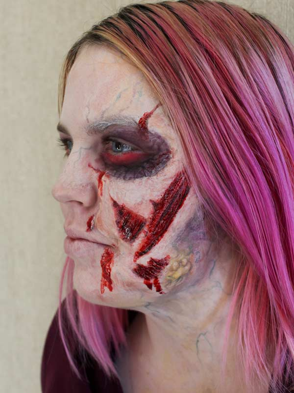 Ripped Face Zombie by Auntie Stacey Dennick, www.auntiestaceysfacepainting.com special effects, fantasy makeup for the San Francisco Bay Area
