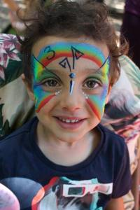 Rainbow butterfly for a three year old's birthday party by www.auntiestaceysfacepainting.com SF Bay area face painter Auntie Stacey Dennick