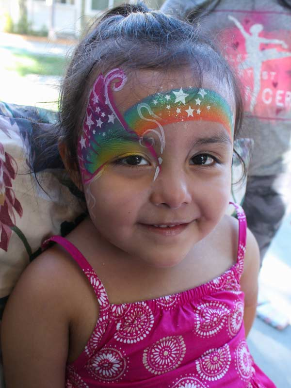 Rainbow Butterfly by www.auntiestaceysfacepainting.com SF Bay area face painter Auntie Stacey Dennick best face painter Marin county