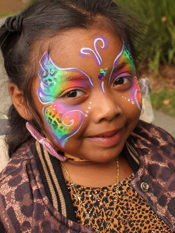 Butterfly leopard face paint by Auntie Stacey's face painting, balloon twisting, children's entertainer, fun and games, best wine country face painter, Sonoma county