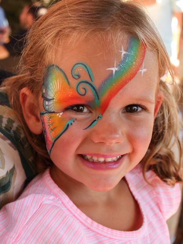 Rainbow butterfly face paint by Auntie Stacey's Face Painting, Sonoma county, Santa Rosa, Sebastopol, Petaluma, wine country face painter, SF bay area face painter