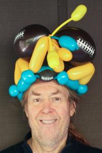 Football balloon hat by Auntie Stacey's Face Painting, balloon twisting, children's entertainment, party, kids, clown, fun, wine country face painter (415) 246-1227