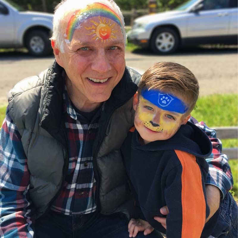 Grandpa with Chase from Paw Patrol by Auntie Stacey's Face painting, Santa Rosa, SF Bay area, balloons, children's entertainment