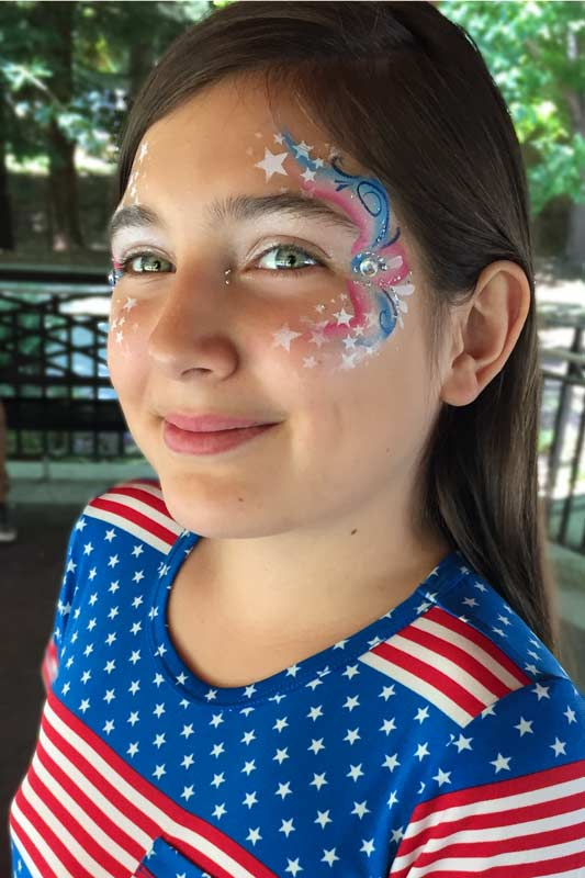 face painting by Auntie Stacey Sonoma county SF bay area face painter balloons July 4th eye bling