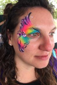 Rainbow eye Auntie Stacey's Face Painting, balloon twisting, children's entertainment, party, kids, clown, fun, wine country face painter