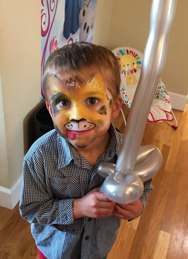 Dog with balloon sword by Auntie Stacey's Face painting balloon twisting San Francisco bay area, Marin, Sonoma, Santa Rosa, San Rafael, children's entertainment