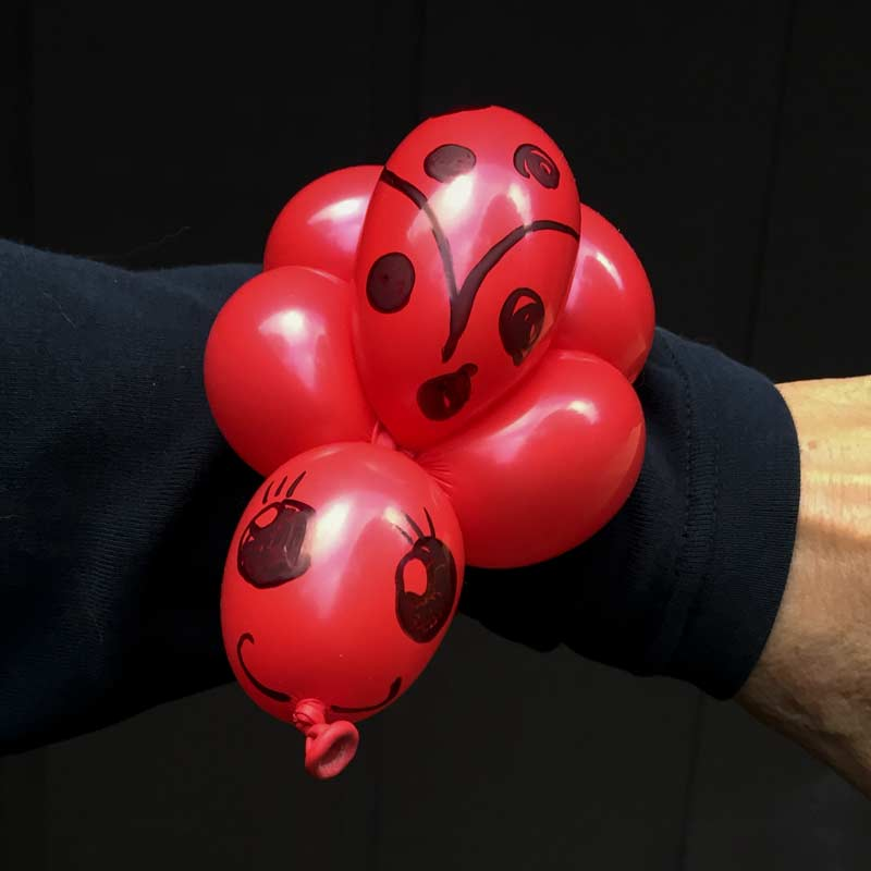 Ladybug balloon bracelet buddy by Auntie Stacey's Face Painting balloon twisting children's party entertainer SF Bay Area fun for kids birthday corporate event Santa Rosa Marin