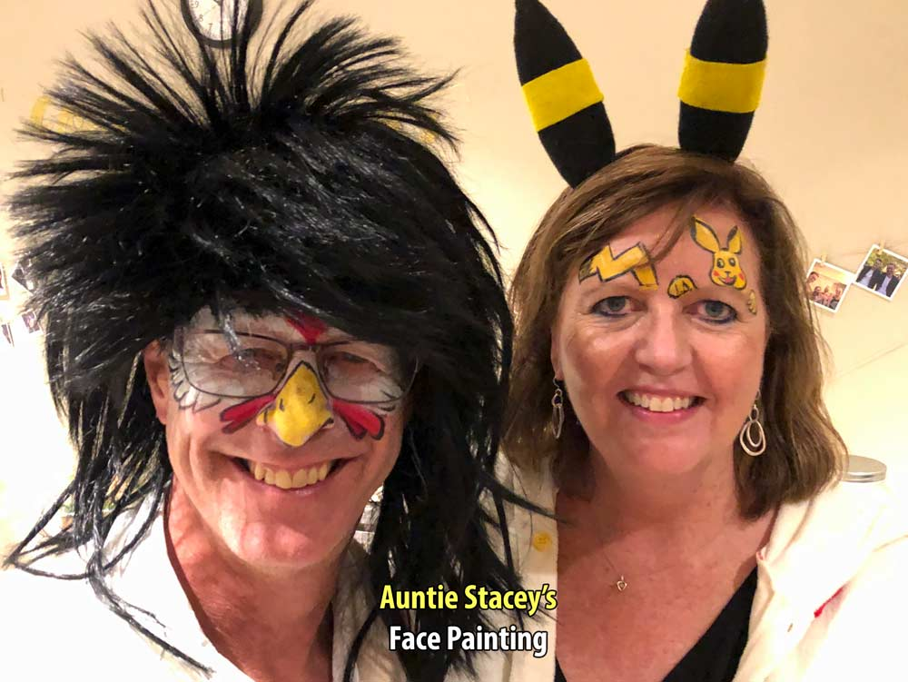 Chicken and Pikachu face paint by Auntie Stacey's Face Painting, Sebastopol, CA